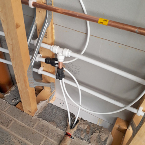 Joist cabling with plastic push-fit pipe