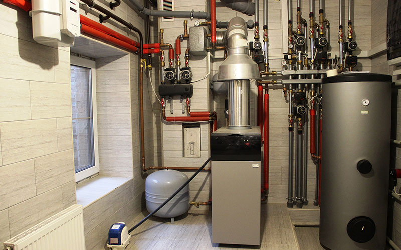 House boiler, water heater, expansion tank and other pipes. new modern independent heating system in boiler room, gas