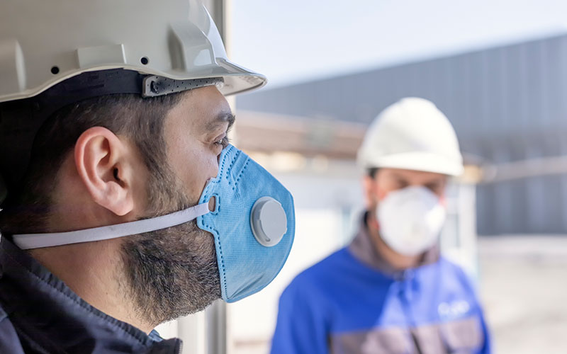 The workers are using personal protective equipments. For healthcare professionals caring for people with covid-19, the CDC recommends placing the person in an airborne infection isolation room.